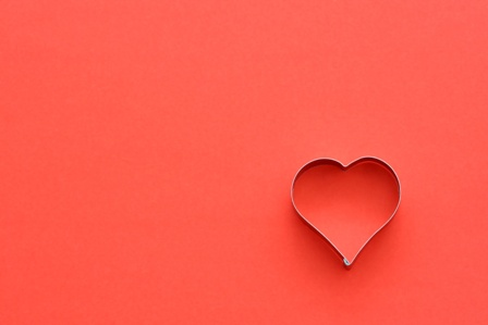 Heart symbol in red, symbolizes love/romance
